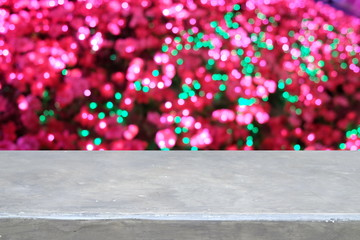 Empty stone table over blur pink and green light bokeh abstract background. Ready for luxury product display montage.