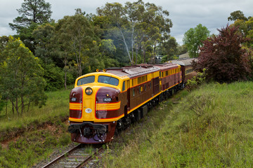Two heritage diesel locomotives depart from Kandos, Australia.