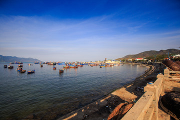 distant group of Vietnamese fishing boats in azure sea