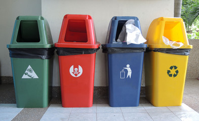 Different colored plastic trash recycling container ecology concept