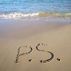 P.S. written on wet sand
