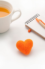 Knitted fabrics heart shape, Note paper and orange juice isolate