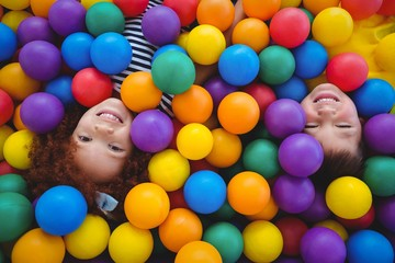 Cute smiling kids in sponge ball pool