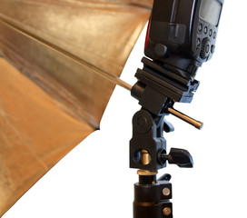 Light stand with flash and umbrella holder close up