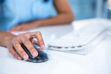 Cropped image of businesswoman using mouse