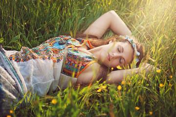 Beautiful hippie woman peacefully sleep