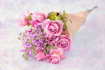 Bouquet of a pink roses on a colorful background .Floral gift for a wedding or birthday.