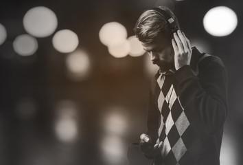 Young modern man listening music