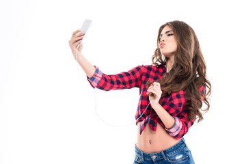 Cute lovely young woman making duck face and taking selfie