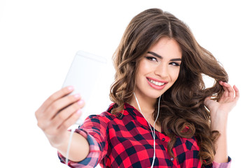 Cheerful attractive young woman smiling and taking selfie