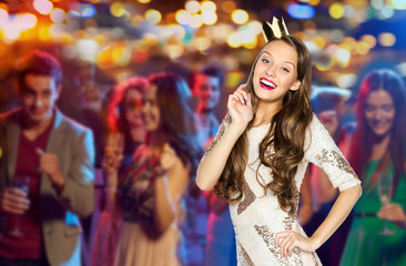 happy young woman or girl in party dress and crown