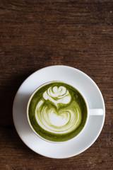 matcha green tea latte with rose pattern latte art