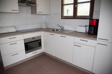 The interior of a small white kitchen