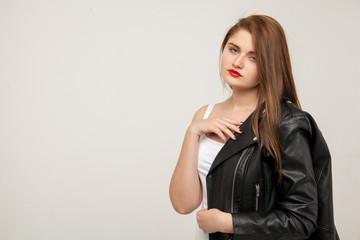 Glamorous woman in black leather jacket isolated on white background