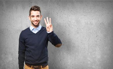 man showing number three