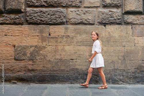 ed37db3cd Outdoor fashion portrait of a pretty little girl