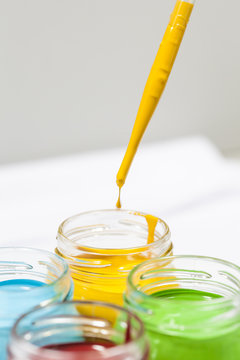 Colorful paints in jars