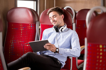 Modern commuter relaxing on train