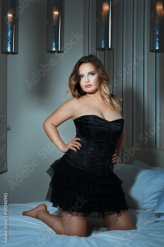 Thick Girl Kneeling On The Bed