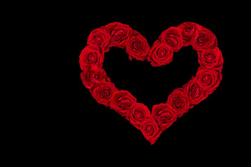 Valentines Day Heart made of Red Roses.  Black Background.