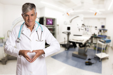 Doctor making a heart with her hands.