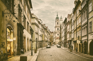 View to the street in the old center of Prague - the capital and largest city of the Czech Republic - vintage sepia retro travel background