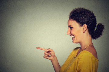 side view profile portrait of attractive woman pointing and laughing at someone