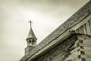Old Wooden Church. Steeple of a historical wooden church in black and white.