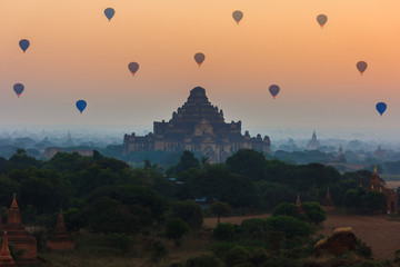 Fotobehang Oranje eclat group of ancient pagodas in Bagan with altitude balloons at the
