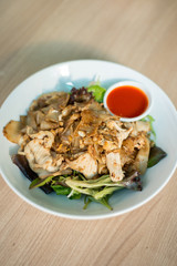 Flat rice noodle stir fried with egg and chicken.
