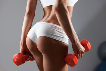 Woman doing exercise with dumbells