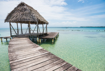 Wooden walkway with old hovel on the sea on Bocas del Toro in Panama