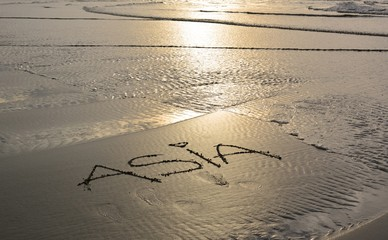 Asia handwritten in sand for natural, symbol,tourism or conceptual design
