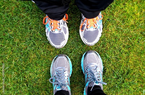 Two Pair Of Running Shoes In The Grass