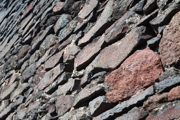 Detail view of a stone wall background. Selective focus