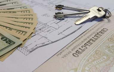 Ключи, деньги, свидетельство о собственности, план дома, квартиры