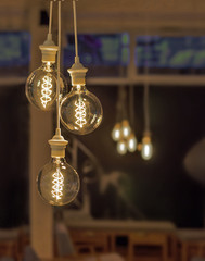 Retro style lighting decor with blur coffee shop background