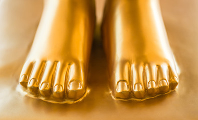 Gold foot of Buddha statue