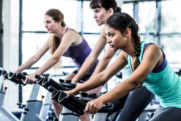 Fit woman working out at spinning class