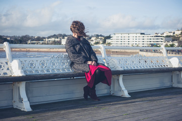 Young woman relaxing on the pier