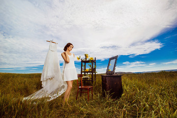 Concept of bride morning. Beautiful bride is standing at field