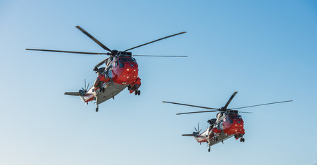 Two rescue helicopters from HMS Gannet