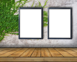 Two big blank billboard attached to a ivy wall with wooden floor