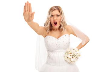 Displeased bride making a stop hand gesture