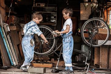 Children mechanics, bicycle repair