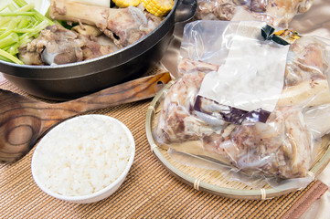 Chinese New Year dishes.Big bone pork pot,Pig bone ready-to-eat food packets,a bowl of rice