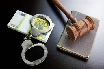 Judges Gavel, Handcuffs, Euro Cash And Book On  Black Table