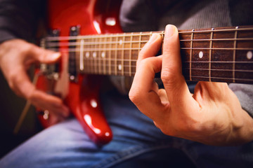 A men playing guitar