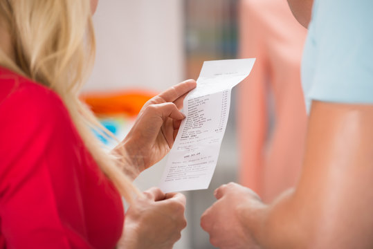 Couple With Shopping Receipt In Store