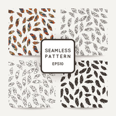 Set of vector seamless pattern of feathers. Doodle. Zentangle